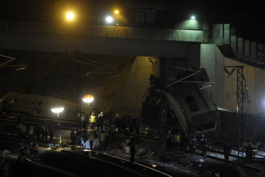 A picture taken on July 25, 2013 shows the site of a train accident near the city of Santiago de Compostela. -- PHOTO: AFP