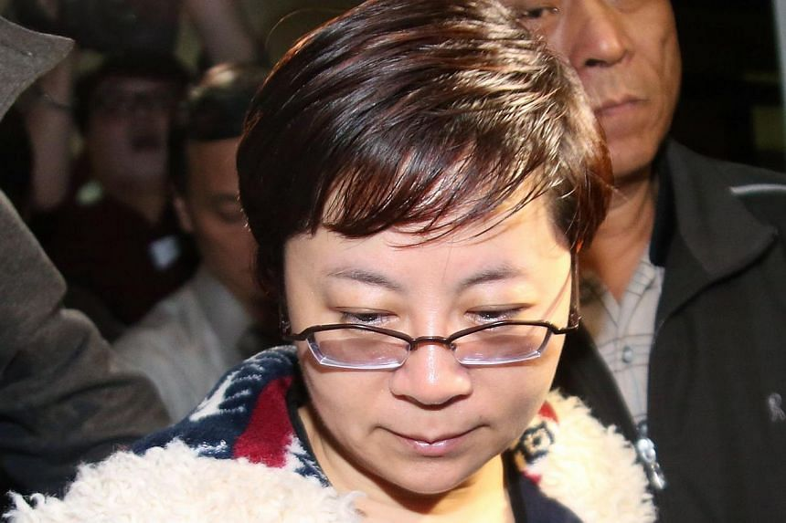 Lai Su-ju, a member of the Taipei City Council, leaves the Taipei District Court on March 29, 2013. Lai, known for her close ties with the president, was indicted on Thursday on corruption charges, a prosecutor said. -- FILE PHOTO: AFP