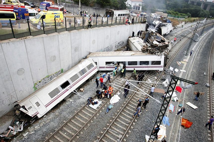 Derailed cars at the site of a train accident near the city of Santiago de Compostela on Wednesday, July 24, 2013. One driver of the Spanish train which derailed on Wednesday in the north-western region of Galicia, killing 78 people and injuring arou
