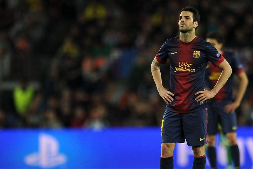 Barcelona's midfielder Cesc Fabregas reacts during the UEFA Champions League semi-final second leg football match against Bayern Munich at the Camp Nou stadium in Barcelona on Wednesday, May 1, 2013. Manchester United boss David Moyes said on Thursda