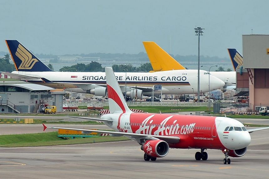 Changi Airport's biggest ground-handling firm, Sats, has reported a 12 per cent increase in first-quarter profits to $46.2 million. -- ST FILE PHOTO: ALPHONSUS CHERN