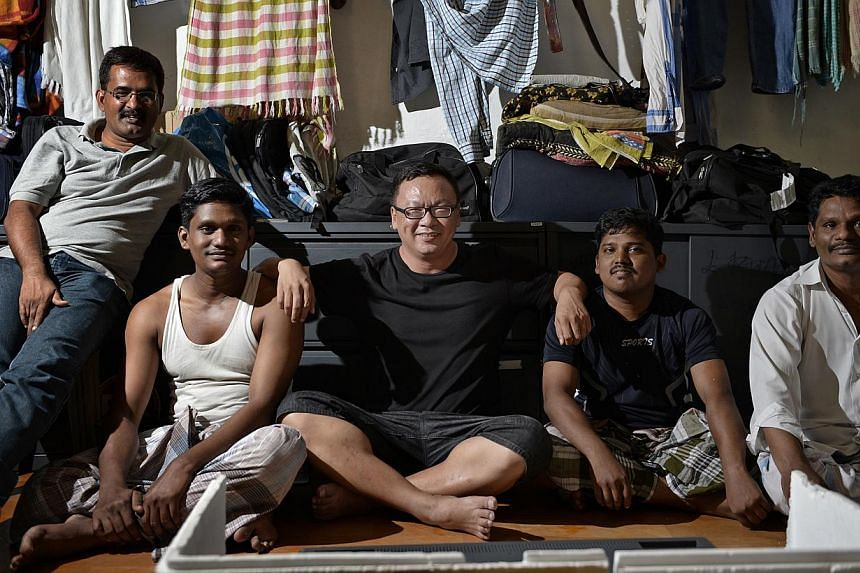 Mr Chia Aik Beng (centre), 45, who is a graphic designer by day and a street photographer by night. -- ST PHOTO: DESMOND LIM