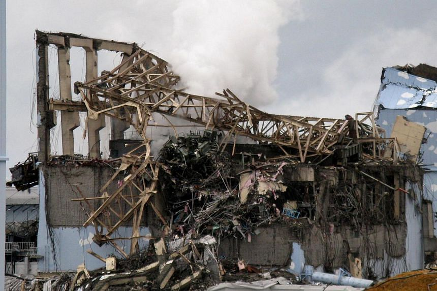 This handout picture taken by Tokyo Electric Power Co (Tepco) on March 15, 2011, shows the crippled Fukushima Dai-ichi nuclear plant's unit 3 reactor building at Okuma town in Fukushima prefecture. The cooling system for an undamaged reactor at the F