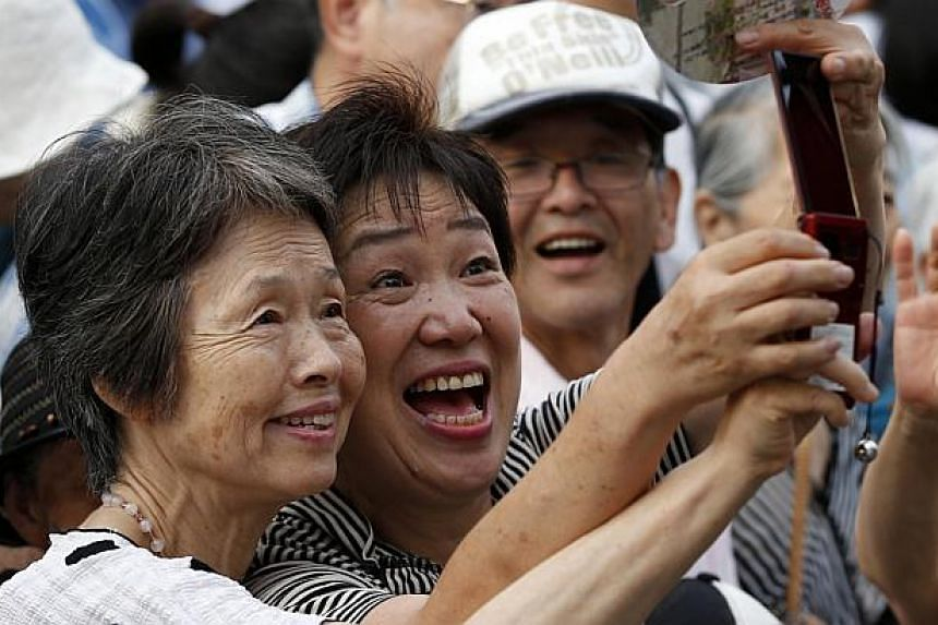 Japan's women retook their place as the world's longest-lived last year, edging out Hong Kongers as their life expectancy bounced back from the dip caused by the 2011 tsunami, officials said on Thursday, July 25, 2013. -- FILE PHOTO: REUTERS