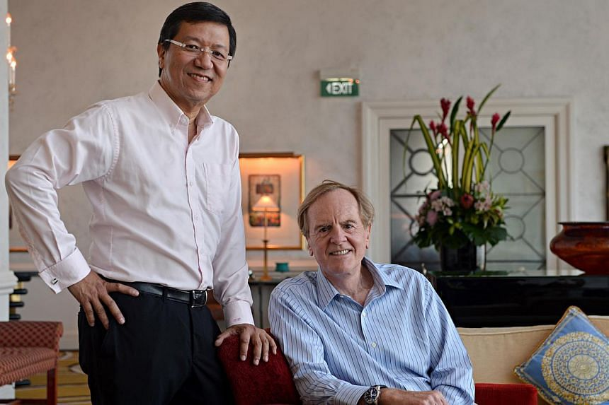 SiS Technologies' chief executive K.H. Lim with InflexionPoint's John Sculley. They will work together to invest in businesses such as IT distribution and health care. -- ST PHOTO: NURIA LING