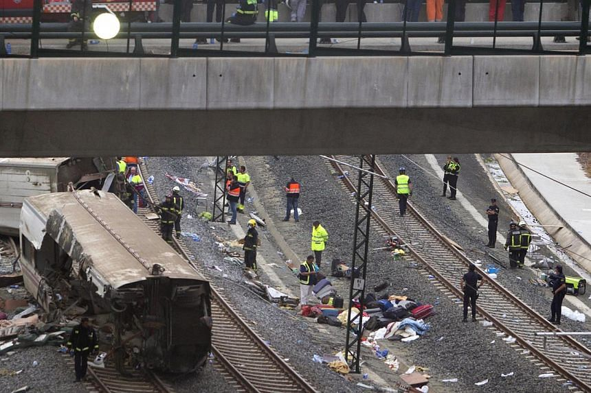 Emergency personnel work at the site of a train accident in Santiago de Compostela, Spain, on Thursday, July 25, 2013. -- PHOTO: AP