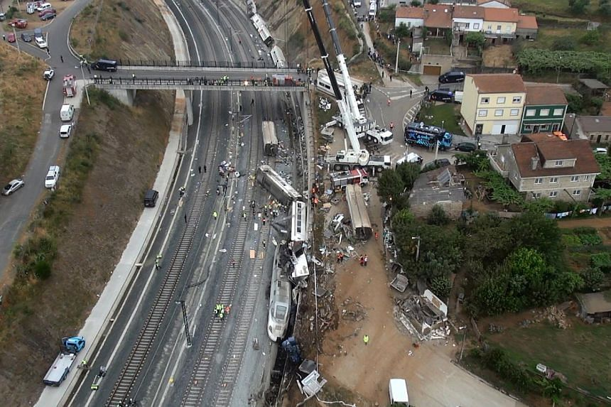 An aerial view shows the site of a train accident near the city of Santiago de Compostela on Thursday, July 25, 2013. -- PHOTO: AFP