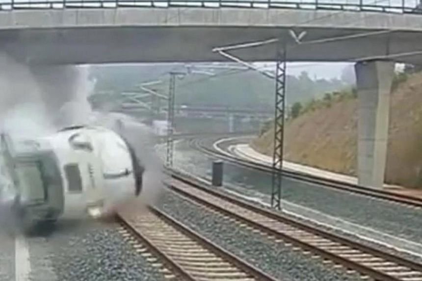 This image taken from security camera video shows a train derailing in Santiago de Compostela, Spain, on Wedmesday July 24, 2013. Speeding is the main suspect on Thursday in a rail disaster in Spain that killed 80 people and left more than 140 i