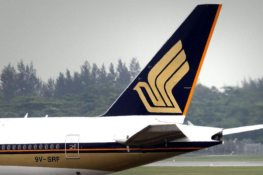 Singapore Airlines (SIA) has cut pilot training time by three months and will close one of its two facilities in Australia. -- ST FILE PHOTO: KEVIN LIM