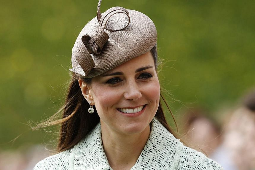 Britain's Catherine, Duchess of Cambridge, attends the National Review of Queen's Scouts at Windsor Castle in Berkshire in this file photo taken on April 21, 2013. A photographer suspected of having taken topless photographs of the wife of the