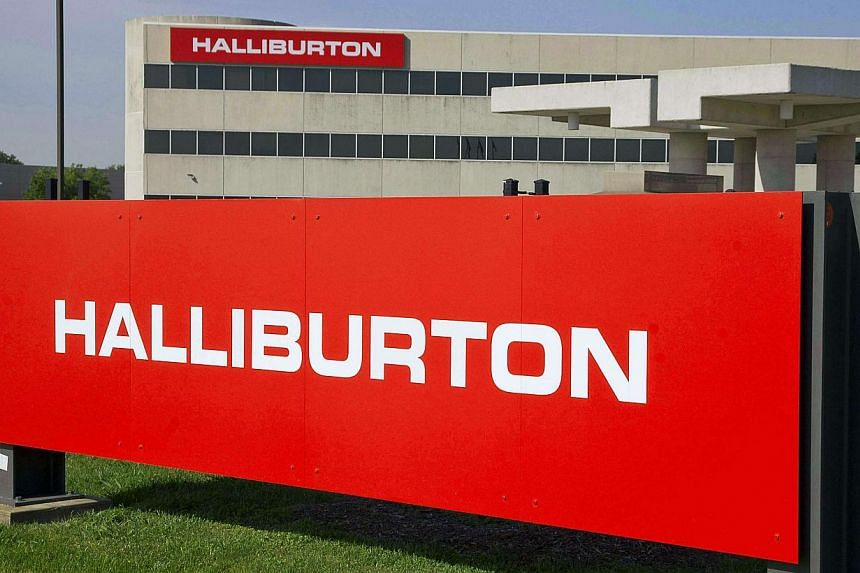 The company logo of Halliburton oilfield services corporate offices is seen in Houston, Texas in this April 6, 2012 file photo. Halliburton Co has agreed to plead guilty to destroying evidence related to the 2010 Gulf of Mexico oil spill, the Un