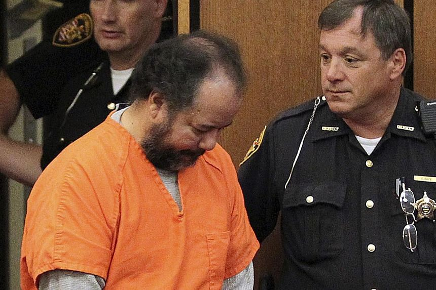 Ariel Castro, 53, walks into the court room with his head down for a pre-trial hearing on charges including rape, kidnapping and murder in Cleveland, Ohio July 24, 2013. Ohio prosecutors have offered Castro a plea deal to avoid a trial. -- PHOTO: REU