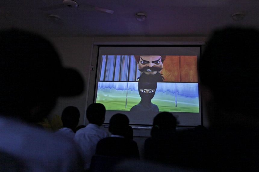 Pakistani orphans watch an early screening of the first episode of the animates Burka Avenger series, at an orphanage on the outskirts of Islamabad, Pakistan on Monday, March 25, 2013. -- FILE PHOTO: AFP