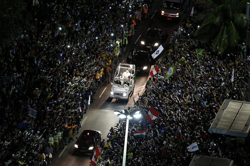 Catholic faithful crowd the streets as Pope Francis arrives at Copacabana beach in Rio de Janeiro on July 25, 2013. Pope Francis is on the fourth day of his week-long visit for World Youth Day. -- PHOTO: REUTERS