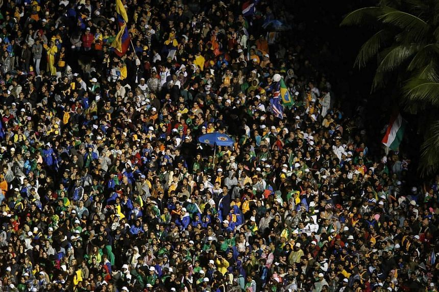 Catholic faithful crowd the streets during the arrival of Pope Francis at Copacabana beach in Rio de Janeiro on July 25, 2013.-- PHOTO: REUTERS
