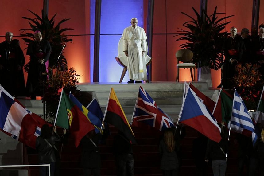 Pope Francis sits on a stage during the welcoming ceremony to the Catholic Church's World Day of Youth in Copacabana beach in Rio de Janeiro on July 25, 2013. -- PHOTO: REUTERS