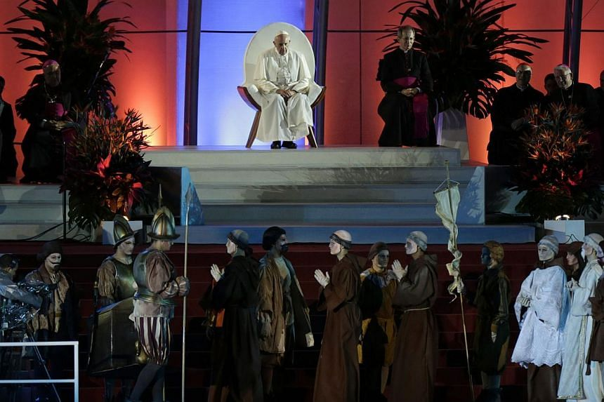 Pope Francis sits on a stage watching youths acting out a skit during the Catholic Church's World Day of Youth at Copacabana beach in Rio de Janeiro on July 25, 2013. -- PHOTO: REUTERS
