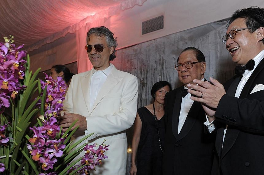 Renowned Italian tenor Andrea Bocelli stands beside the hybrid orchid that was named after him, the Vanda Andrea Bocelli. -- FILE PHOTO: YTL CORPORATION