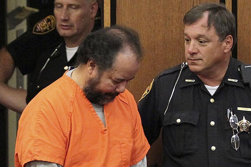 Ariel Castro, 53, walks into the court room with his head down for a pre-trial hearing on charges including rape, kidnapping and murder in Cleveland, Ohio on Wednesday, July 24, 2013. Castro agreed on Friday, July 26, 2013, to plead guilty and serve