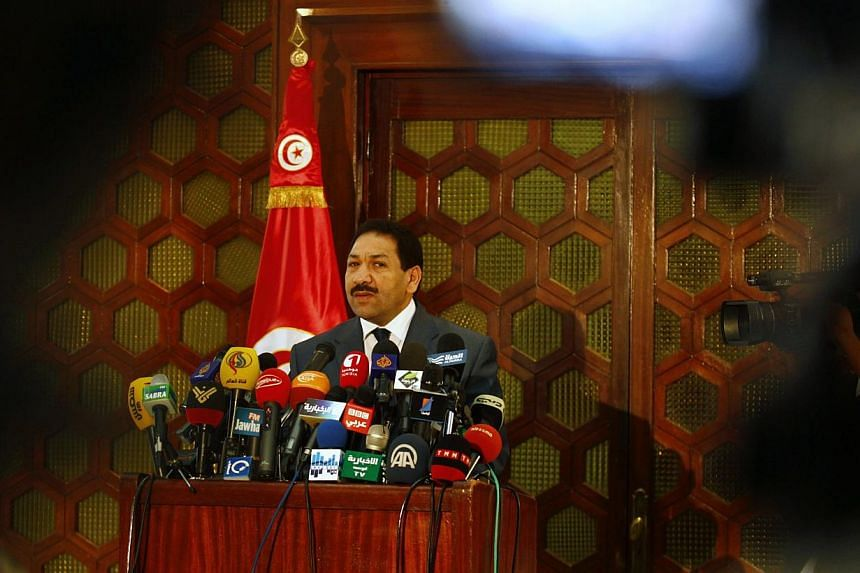 Tunisia's Interior Minister Lotfi Ben Jeddou (above) says the same weapon used to assassinate a leftist politician on Thursday, July 25, 2013, was also used in an assassination in February, in a news conference in Tunis on Friday, July 26, 2013. -- P
