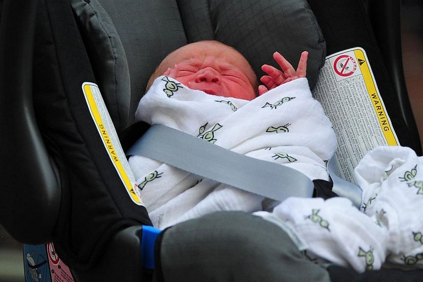 Prince William and Catherine, Duchess of Cambridge' new-born baby boy is seen in a car seat outside the Lindo Wing of St Mary's Hospital in London on Tuesday, July 23, 2013. Fans of the royal baby may now get their hands on limited edition commemorat