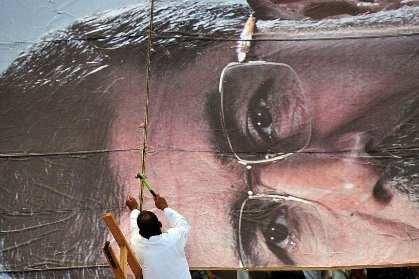 An Egyptian supporter of deposed president Mohamed Mursi builds a giant portrait of him as Mr Mursi's supporters continue to hold a sit-in outside Rabaa al-Adawiya mosque in Cairo on Thursday, July 25, 2013. -- PHOTO: AFP