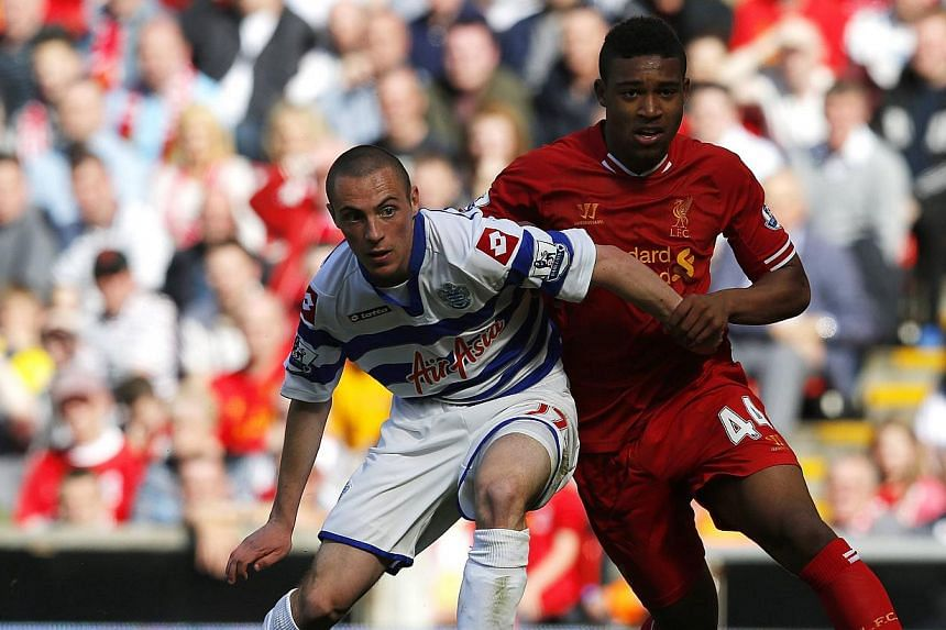 Liverpool's Jordan Ibe (right) challenges Queens Park Rangers' Michael Harriman during their English Premier League (EPL) soccer match at Anfield in Liverpool, northern England on May 19, 2013. The next three seasons of the EPL will be available to b