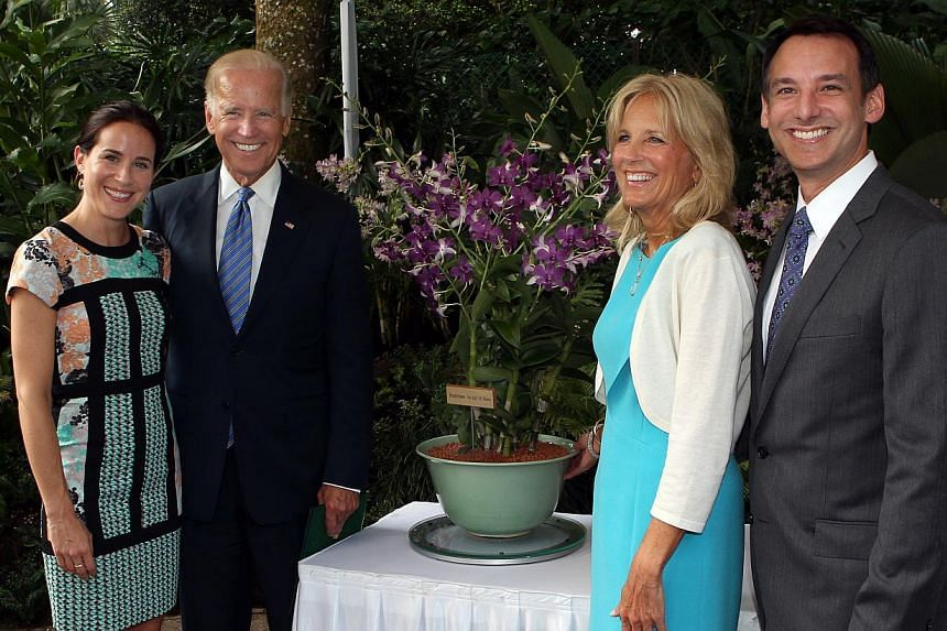 US Vice-President Joe Biden poses with his family during a hybrid orchid naming ceremony at the National Orchid Garden in Singapore on Friday, July 26, 2013. -- ST PHOTO: LAU FOOK KONG