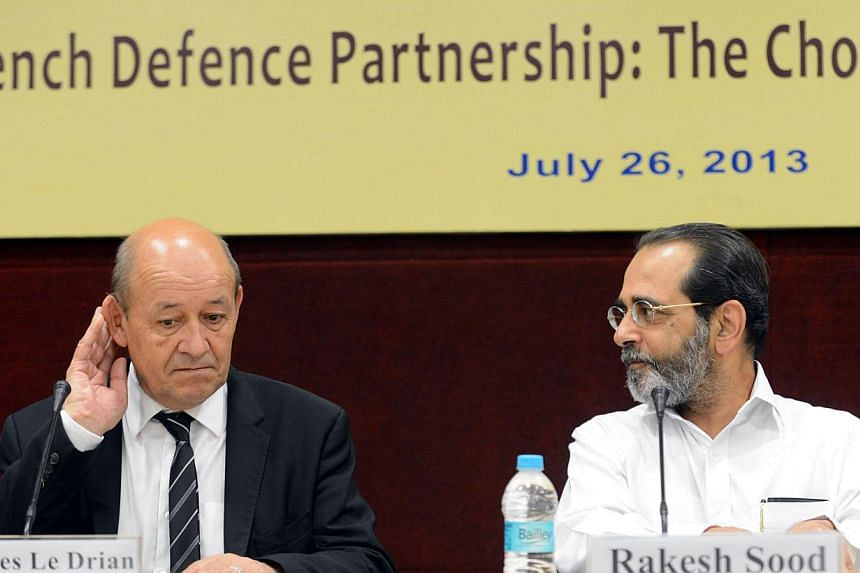 French Defence Minister Jean-Yves Le Drian (left) and Indian Ambassador to France Rakesh Sood attend a meeting in New Delhi on Friday, July 26, 2013. Mr Le Drian said on Friday that talks over a US$12 billion (S$15 billion) deal to sell Rafale jets t