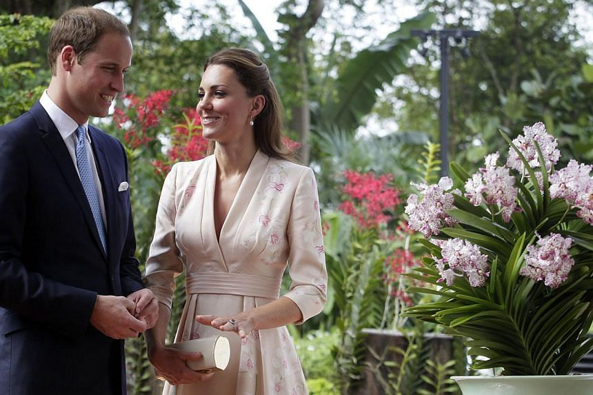 Prince William and his wife Catherine Middleton smile as the white and purple orchid (right) is named after them at the National Orchid Garden of the Botanic Gardens. -- ST FILE PHOTO: KEVIN LIM