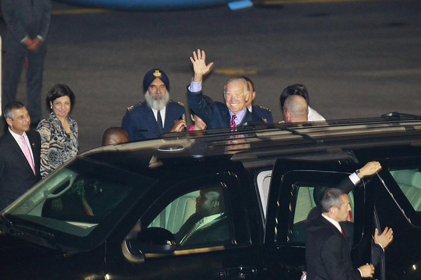 US Vice-President Joe Biden waves to the media after he arrived with his wife Jill at Paya Lebar Airbase for his first-ever visit to Singapore. -- ST PHOTO: KEVIN LIM