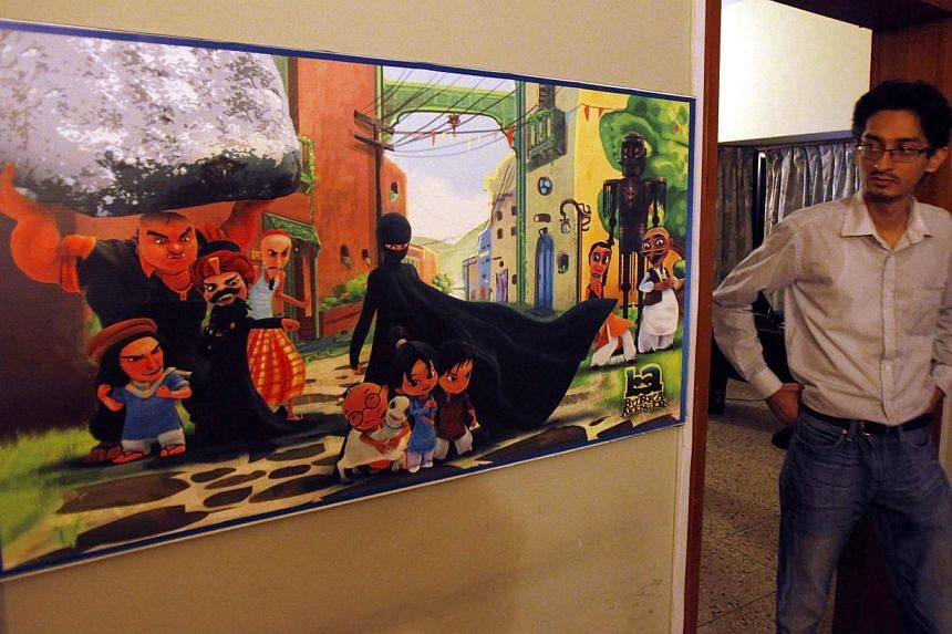 A Pakistani man looks at a poster of the animated Burka Avenger series on display at an office in Islamabad, Pakistan, on Wednesday, July 24, 2014. -- FILE PHOTO: AP