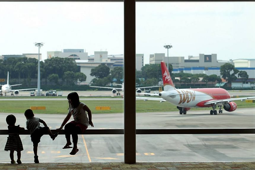 Children at the viewing gallery of Terminal 1 of Changi Airport. Plans for Changi Airport's biggest expansion in more than three decades will be released next month. -- ST FILE PHOTO: SEAH KWANG PENG