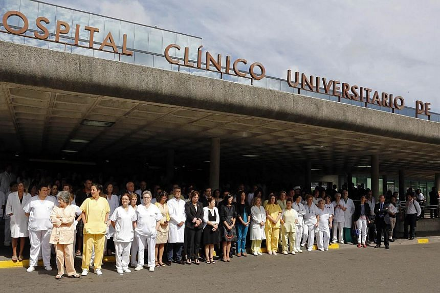 The medical staff of the University Clinical Hospital hold five minutes of silence on July 26, 2013, to pay tribute to the victims of a train crash at the Obradoiro Square in Santiago de Compostela. After the deadly high-speed train crash that struck
