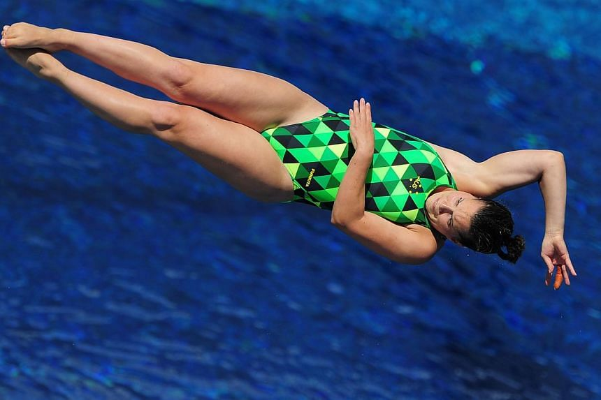 Australia's Anabelle Smithcompetes in the women's 3m springboard semi-final diving event in the Fina World Championships at the Piscina Municipal de Montjuic in Barcelona on Friday, July 26, 2013. -- PHOTO: AFP