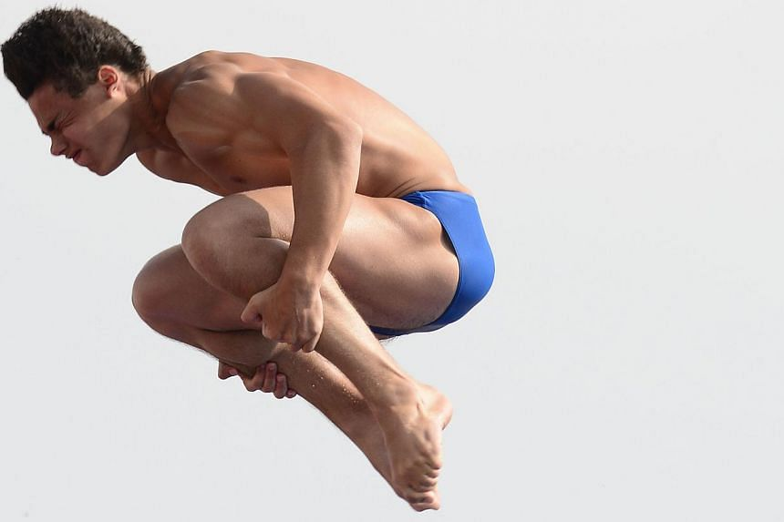Italy's Andrea Chiarabini competes in the men's 10m platform semi-final diving event in the Fina World Championships at the Piscina Municipal de Montjuic in Barcelona on Saturday, July 27, 2013. -- PHOTO: AFP