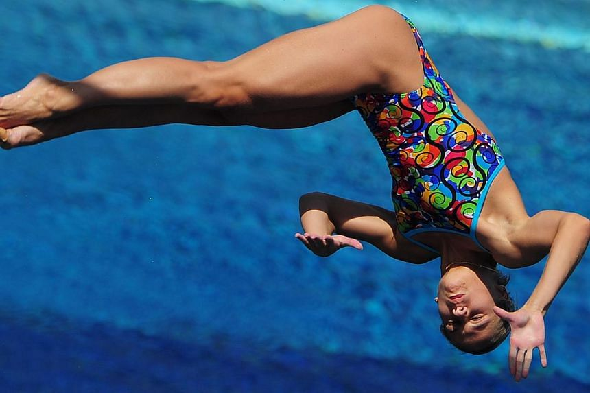 Ukraine's Anna Pysmenska competes in the women's 3m springboard semi-final diving event in the Fina World Championships at the Piscina Municipal de Montjuic in Barcelona on Friday, July 26, 2013. -- PHOTO: AFP