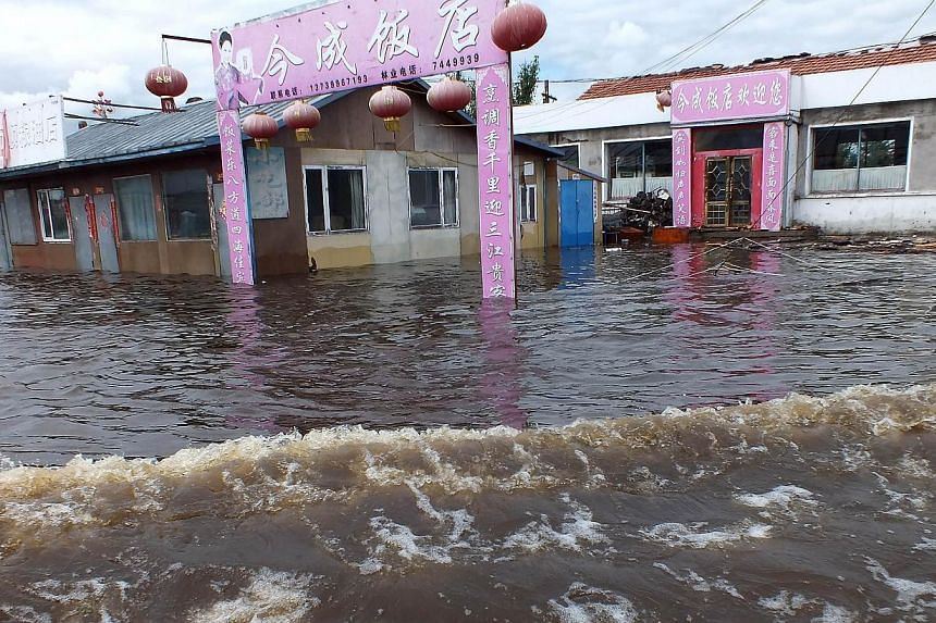 A flooded restaurant is seen in Yakeshi, in northern China's Inner Mongolia region on Thursday, July 25, 2013. -- PHOTO: AFP