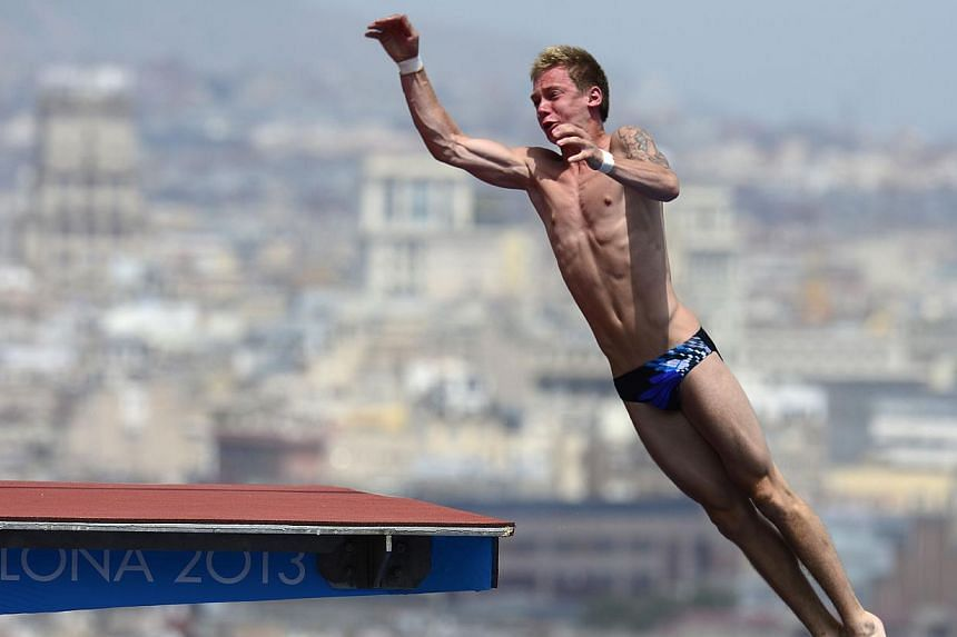 Germany's Dominik Stein competes in the men's 10m platform semi-final diving event in the Fina World Championships at the Piscina Municipal de Montjuic in Barcelona on Saturday, July 27, 2013. -- PHOTO: AFP
