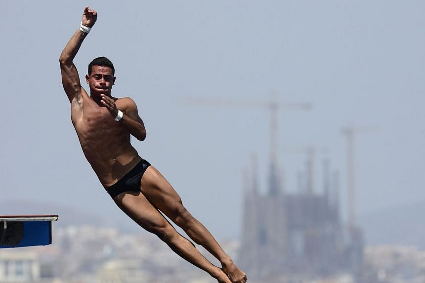 Cuba's Jeinkler Aguirre competes in the men's 10m platform semi-final diving event in the Fina World Championships at the Piscina Municipal de Montjuic in Barcelona on Saturday, July 27, 2013. -- PHOTO: AFP