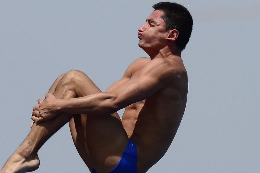 Colombia's Juan Rios Lopera competes in the men's 10m platform semi-final diving event in the Fina World Championships at the Piscina Municipal de Montjuic in Barcelona on Saturday, July 27, 2013. -- PHOTO: AFP