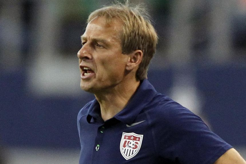 US Head Coach Jurgen Klinsmann directs his team against Honduras during their Concacaf Gold Cup football match in Arlington, Texas on Wednesday, July 24, 2013. Klinsmann won't be on the sideline for his side's Gold Cup final against Panama on Sunday,