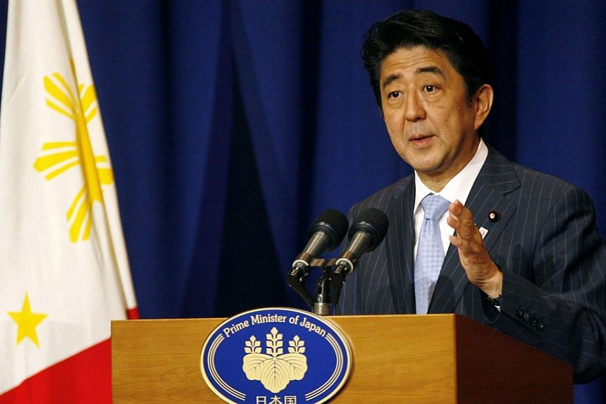Japan's Prime Minister Shinzo Abe at a news conference in Makati city, metro Manila on Saturday, July 27, 2013. Mr Abe said on Saturday he hoped to hold his first summit with South Korean President Park Geun Hye to mend frayed ties between the two co
