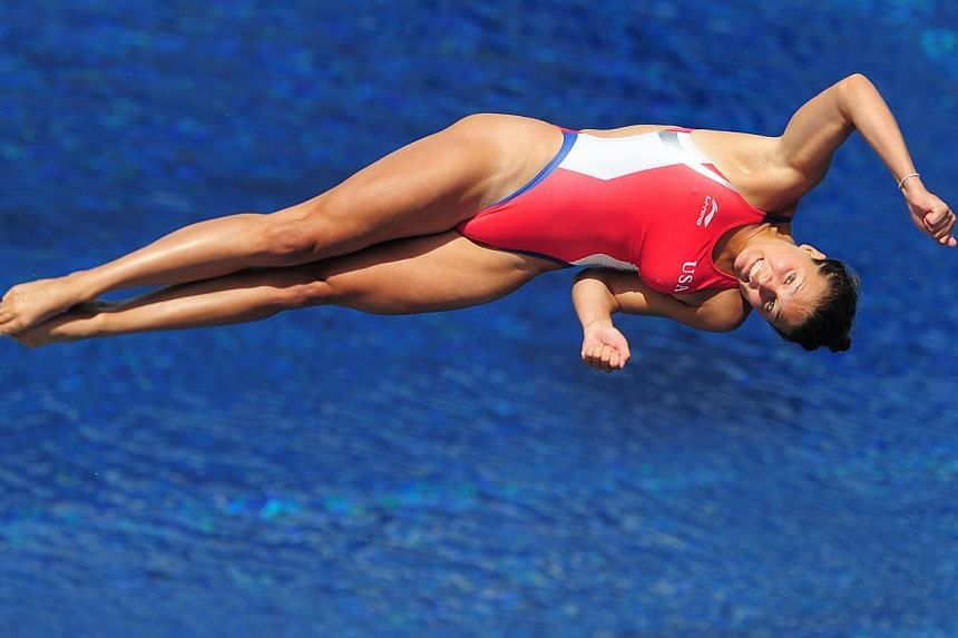 US diver Maren Taylor competes in the women's 3m springboard semi-final diving event in the Fina World Championships at the Piscina Municipal de Montjuic in Barcelona on Friday, July 26, 2013. -- PHOTO: AFP