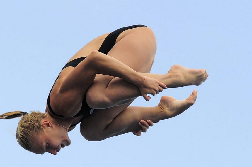 Ukraine's Olena Fedorova competes in the women's 3m springboard semi-final diving event in the Fina World Championships at the Piscina Municipal de Montjuic in Barcelona on Friday, July 26, 2013. -- PHOTO: AFP