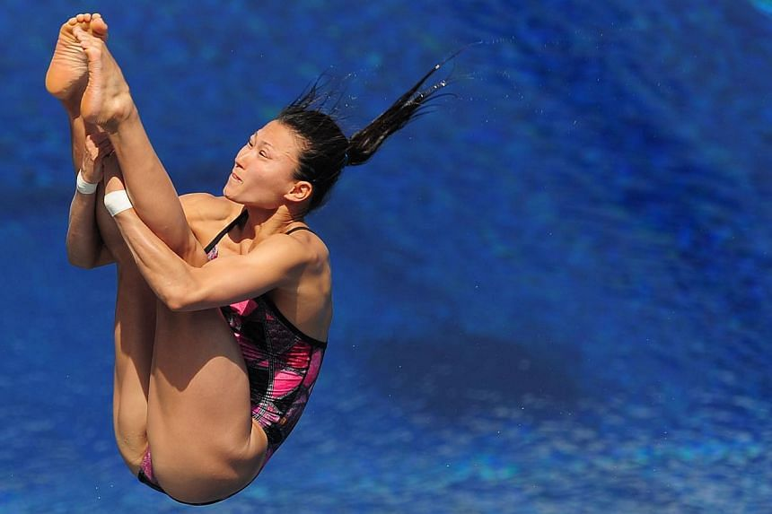 Japan's Sayaka Shibusawa competes in the women's 3m springboard semi-final diving event in the Fina World Championships at the Piscina Municipal de Montjuic in Barcelona on Friday, July 26, 2013. -- PHOTO: AFP