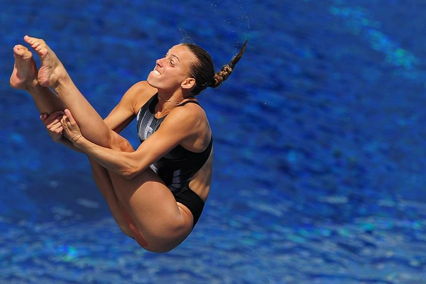 Italy's Tania Cagnotto competes in the women's 3m springboard semi-final diving event in the Fina World Championships at the Piscina Municipal de Montjuic in Barcelona on Friday, July 26, 2013. -- PHOTO: AFP