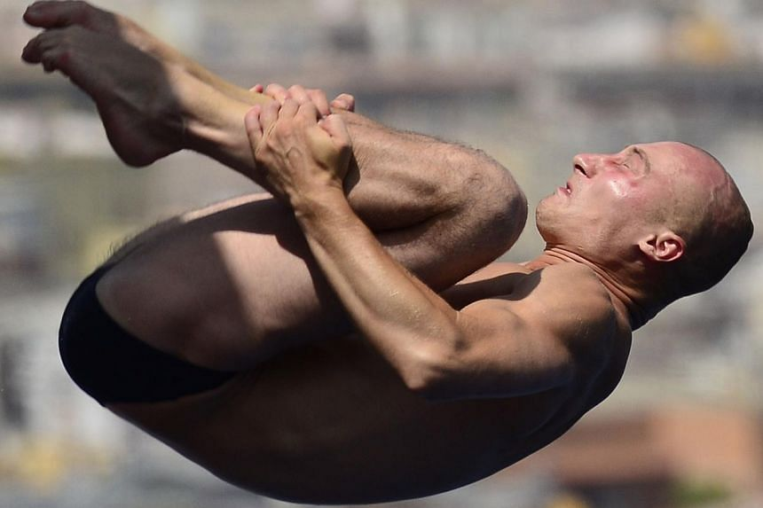 Belarus's Vadim Kaptur competes in the men's 10m platform semi-final diving event in the Fina World Championships at the Piscina Municipal de Montjuic in Barcelona on Saturday, July 27, 2013. -- PHOTO: AFP