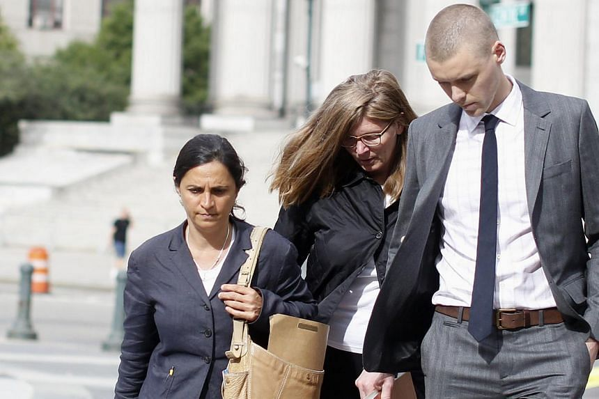 Ingrid Lederhaas-Okun (centre) departs Manhattan Federal Court with her lawyer in New York, on July 2, 2013. -- FILE PHOTO: REUTERS