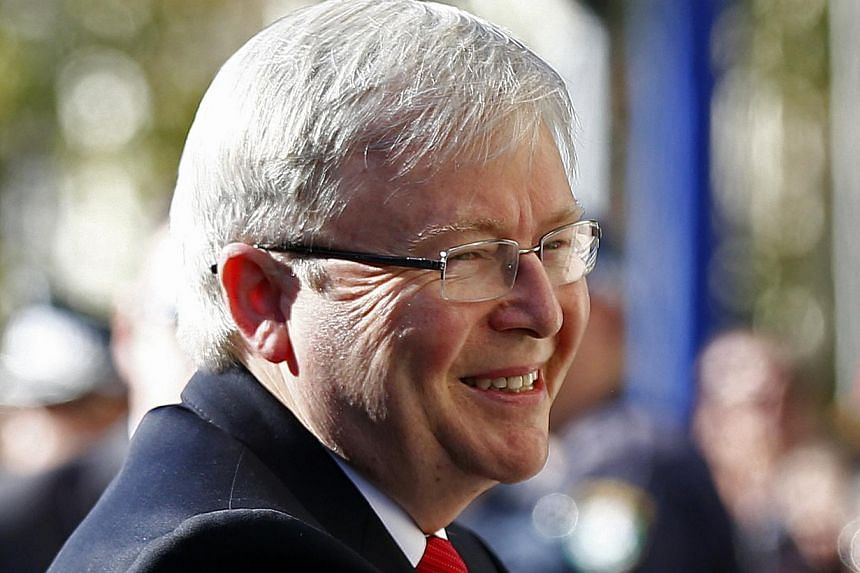 Australian Prime Minister Kevin Rudd arrives at a Australian Labor Party caucus meeting to vote on party reforms, in Sydney July 22, 2013. Australian Prime Minister Kevin Rudd has made a surprise visit to troops serving in Afghanistan, telling them t